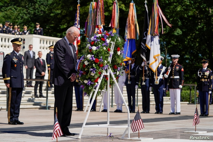 U.S. President Joe Biden takes part in a wreath-laying ceremony during the National Memorial Day Observance, at Arlington National Cemetery, in Arlington, Virginia, May 31, 2021.