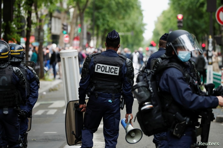 FILE - Police officers stand guard during a protest in support of Palestinians following a flare-up of Israeli-Palestinian violence, in Paris, France, May 15, 2021.