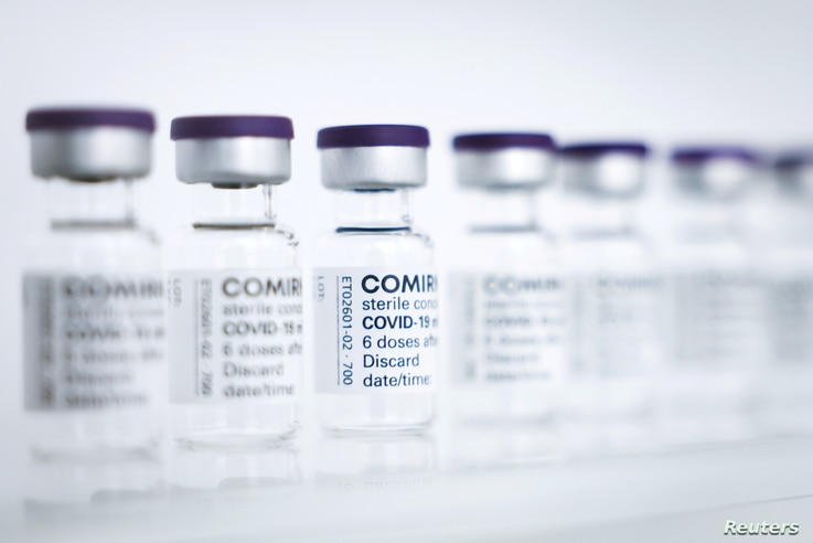 FILE - Empty vials to be filled with the Pfizer/BioNTech vaccine are seen at a production facility in Reinbek, near Hamburg, Germany, April 30, 2021.