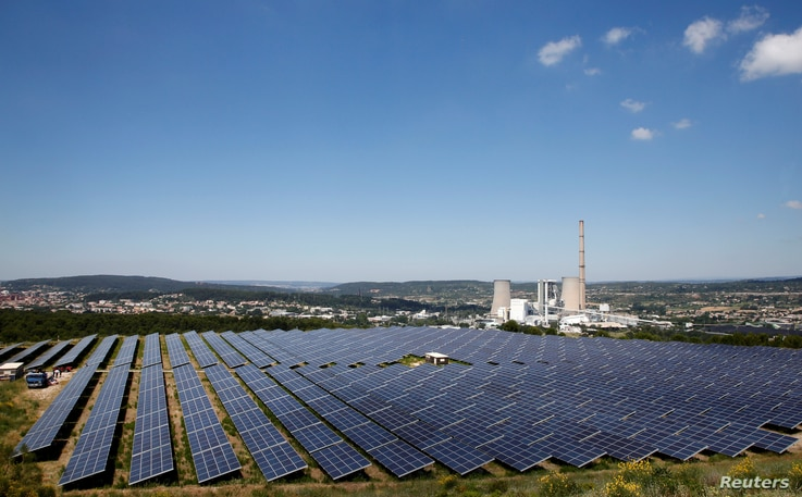 FILE - A general view shows solar panels to produce renewable energy at the Urbasolar photovoltaic park in Gardanne, France, June 25, 2018.