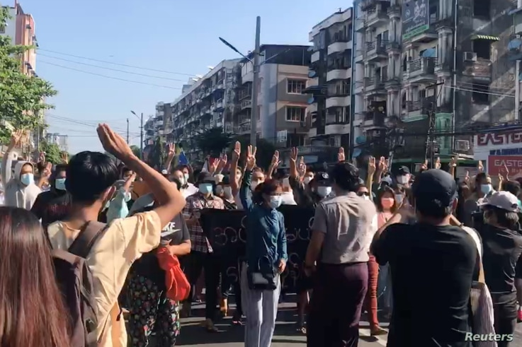 People protest in Hlaing Township, Yangon, Myanmar, May 2, 2021, in this still image from a video.