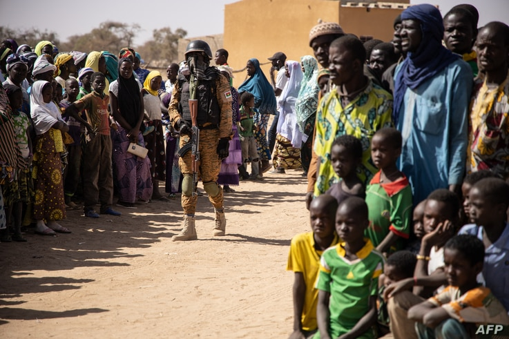 A Burkina Faso soldier patrols at district welcoming Internally Displaced People (IDP) from northern Burkina Faso in Dori, on…