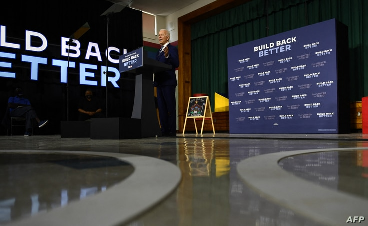 """US Democratic presidential candidate Joe Biden speaks about on the third plank of his """"Build Back Better"""" economic recovery…"""