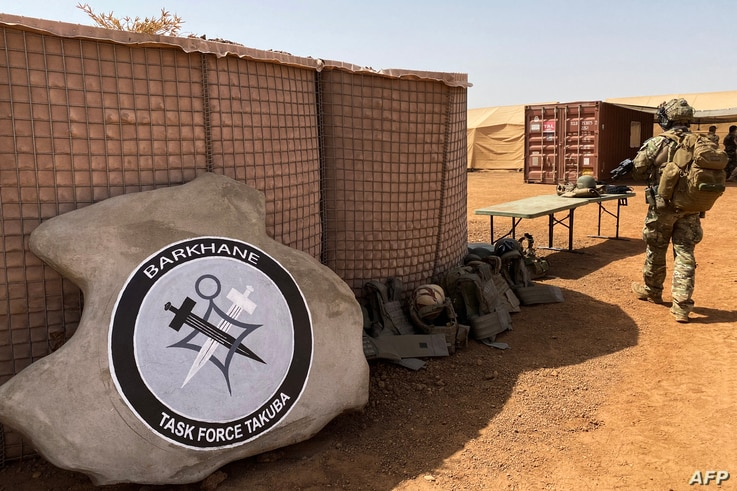 This photograph taken on November 3, 2020 shows the logo of the special operations led by France for the new task force Barkhane Takuba,…