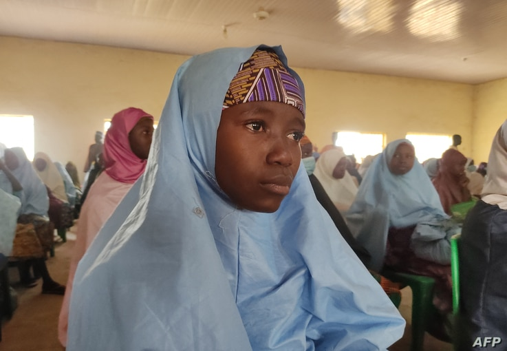 A kidnapped girl, reacts as she prepares to reunite with family members in Jangebe, Zamfara state, on March 3, 2021 after they…