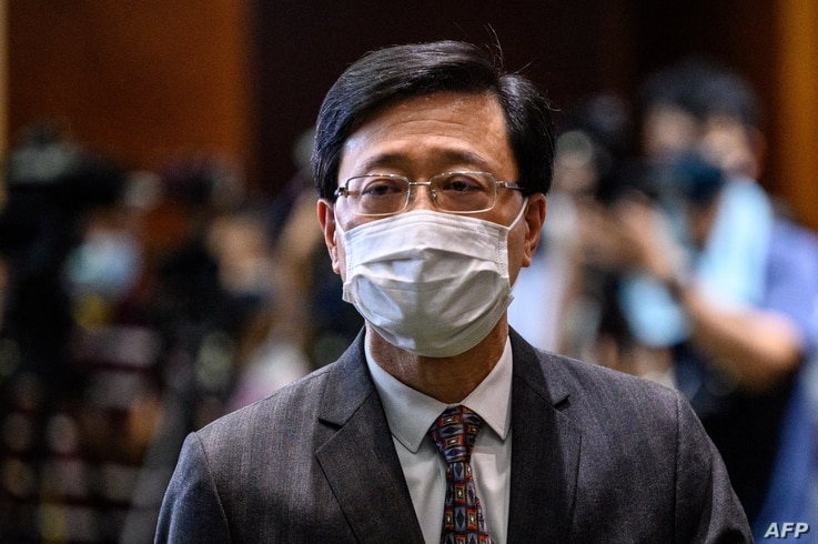 """Hong Kong Secretary for Security John Lee leaves after speaking to the press following the passing of the """"Improving Electoral…"""