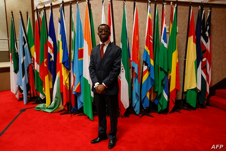 President of the Pan African Parliament Cameroonian Roger Nkodo Dang poses for a photograph inside the house following its…