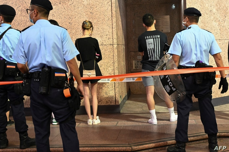 Police detain people near Victoria Park in the Causeway Bay district of Hong Kong on June 4, 2021, after police closed Victoria…