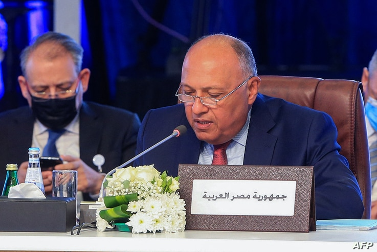 Egypt's Foreign Minister Sameh Shoukry adresses his Arab counterparts during a consultative meeting in the Qatari capital Doha,...