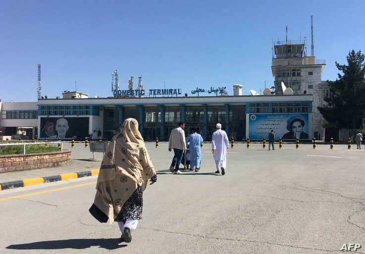 (FILES) In this file photo taken on May 08, 2018, people arrive at the domestic terminal of the Hamid Karzai International…