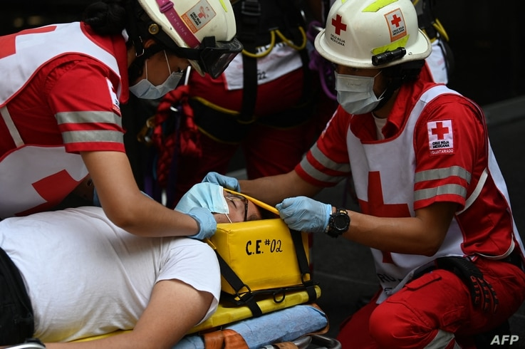 People take part in an earthquake drill, the first since the beginning of the COVID-19 pandemic, in Mexico City on June 21,…