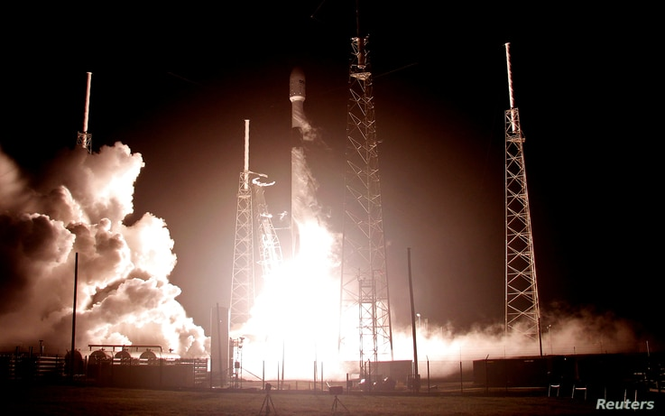 A SpaceX Falcon 9 rocket carrying Israel's first spacecraft designed to land on the moon lifts off on the first privately…