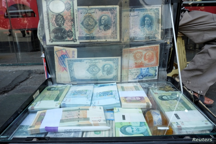 A man displays the Iranian currency at Ferdowsi square in Tehran, Iran July 2, 2020. Picture taken July 2, 2020. Mohamadreza...