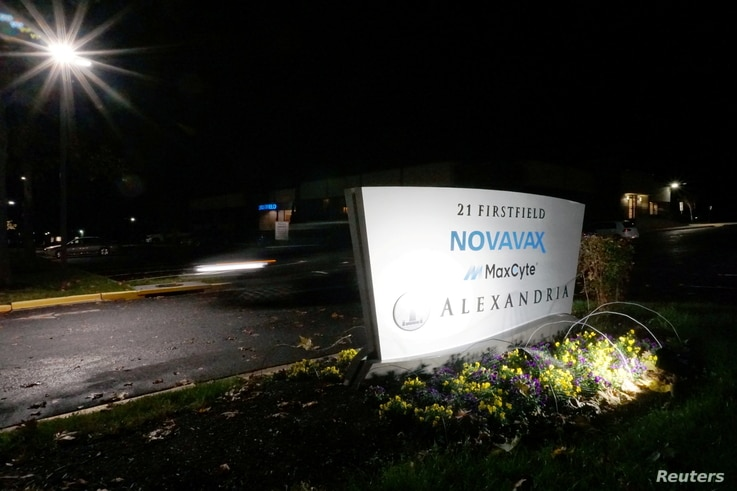 FILE PHOTO: A car drives past the sign for vaccine developer Novavax at the company's headquarters in Gaithersburg, Maryland,…