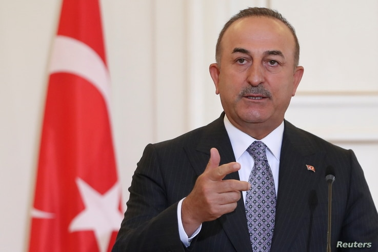 Turkish Foreign Minister Mevlut Cavusoglu speaks during a joint news conference with his Greek counterpart Nikos Dendias at the...