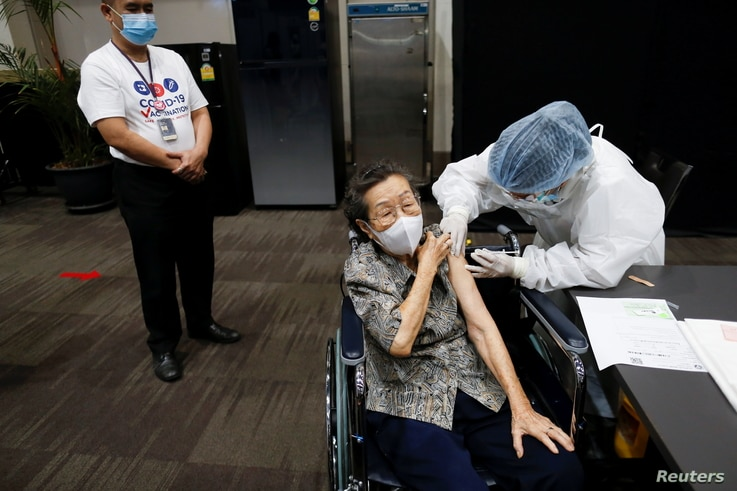 A person receives the first dose of the AstraZeneca COVID-19 vaccine against the coronavirus disease (COVID-19) as Thailand…