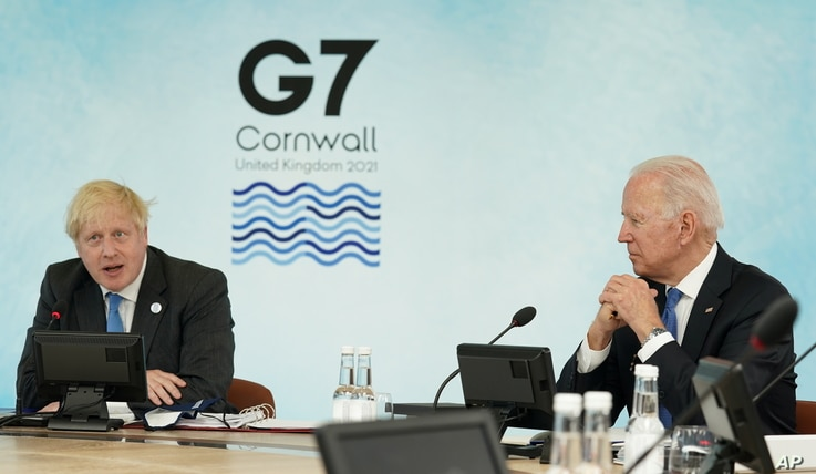 U.S. President Joe Biden and Britain's Prime Minister Boris Johnson attend a session during the G7 summit in Carbis Bay.