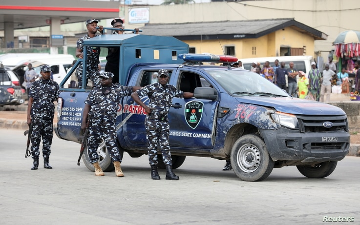 Police officers stand by during a June 12 Democracy Day protest at the Gani Fawehinmi Park, in Ojota, Lagos, Nigeria June 12,...