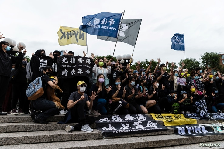 People gather for a rally to mark the second anniversary of the protests in Hong Kong, in Union Square in New York City, June 12, 2021.
