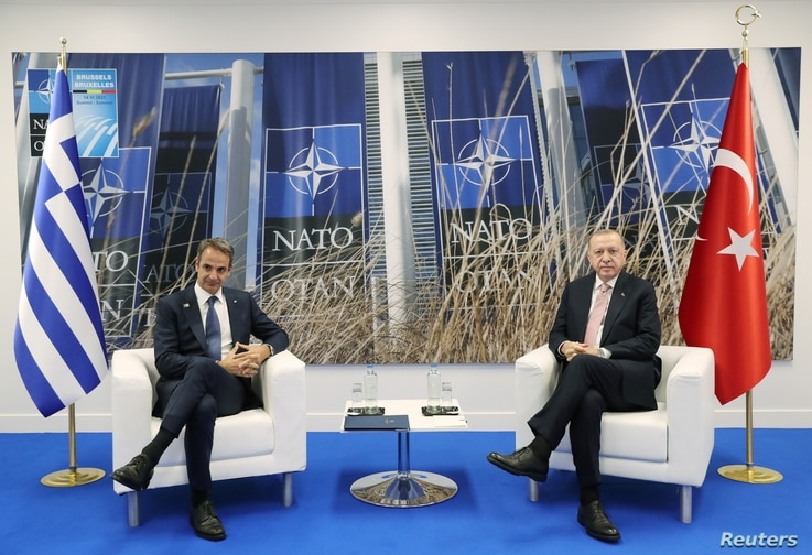 Turkish President Tayyip Erdogan meets with Greece's Prime Minister Kyriakos Mitsotakis?on the sidelines of the NATO summit, in…