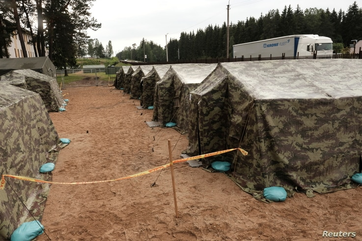 A general view of the newly installed tents in Lithuania's migrant processing centre in Pabrade, Lithuania June 15, 2021…