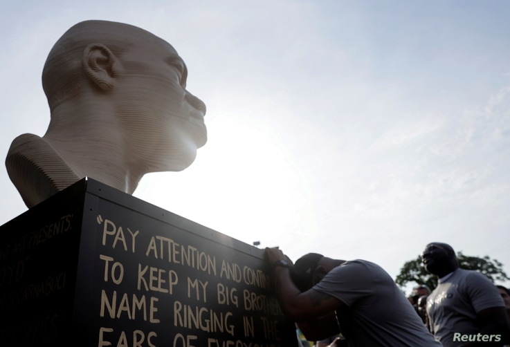 Terrence Floyd, brother of the late George Floyd who was killed by a police officer, reacts during the unveiling event of Floyd's statue, as part of Juneteenth celebrations, in Brooklyn, New York, June 19, 2021.