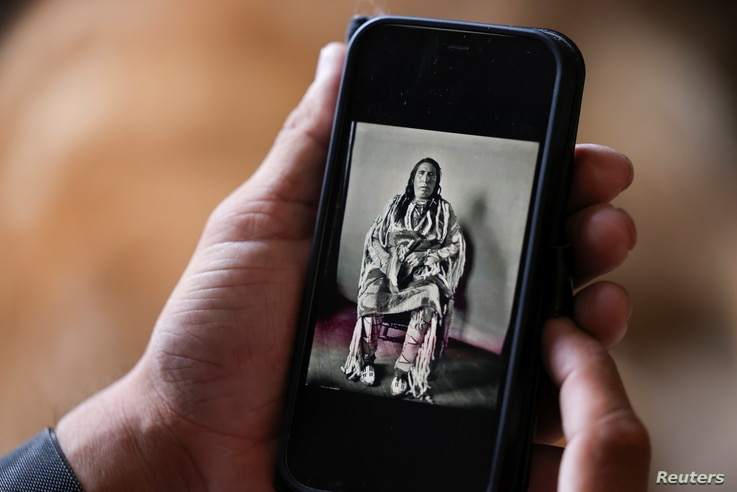 Clarence Smith, who attended both Chemawa Indian School in Oregon and the Flandreau Indian School in South Dakota, looks at a…