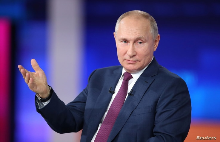 Russian President Vladimir Putin speaks during an annual nationwide televised phone-in show in Moscow, Russia June 30, 2021...