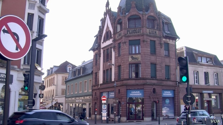 A Peugeot building in downtown Montbeliard in eastern France, once a key jobs supplier. Lisa Bryant.jpg