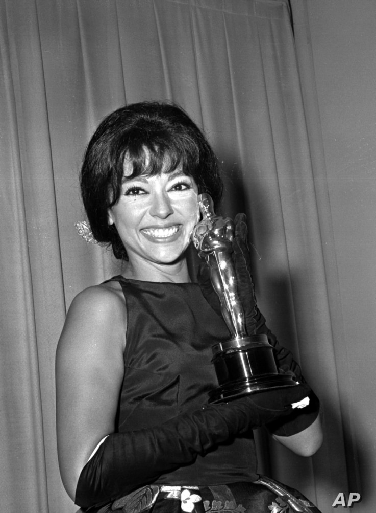 Actress Rita Moreno poses with her Oscar after she was named best supporting actress at the Academy Awards in Los Angeles on...