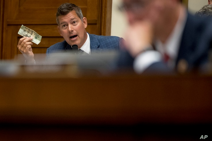 Rep. Sean Duffy, R-Wis., holds up a twenty dollar bill as he questions David Marcus, CEO of Facebook's Calibra digital wallet service, as he appears before a House Financial Services Committee hearing on Facebook's proposed cryptocurrency, July 17, 2019.