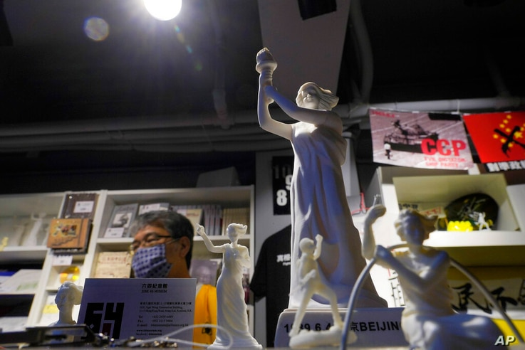"""A small replica of the Goddess of Democracy is displayed at the """"June 4 Memorial Museum"""" run by pro-democracy activists is…"""