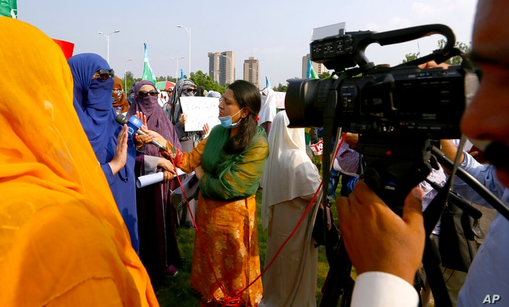 In this Friday, Sept. 11, 2020 photo, Wajiha Khanian, a female journalist from local tv channel Dawn News, interviews during…