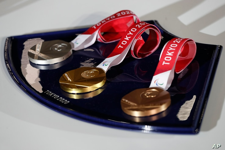 A medal tray that will be used during the victory ceremonies at the Tokyo 2020 Paralympic Games is displayed during an…