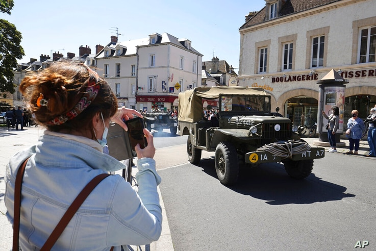 World War II history enthusiasts parade in WWII vehicles in Ouistreham, Normandy, Saturday June, 5 2021 on the eve of 77th…