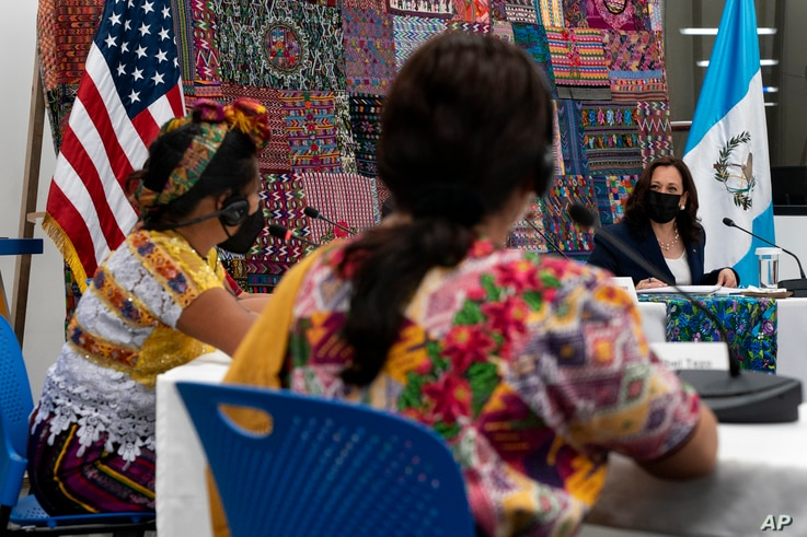 Vice President Kamala Harris, listens as women speak to her about their businesses during a meeting with Guatemalan women...