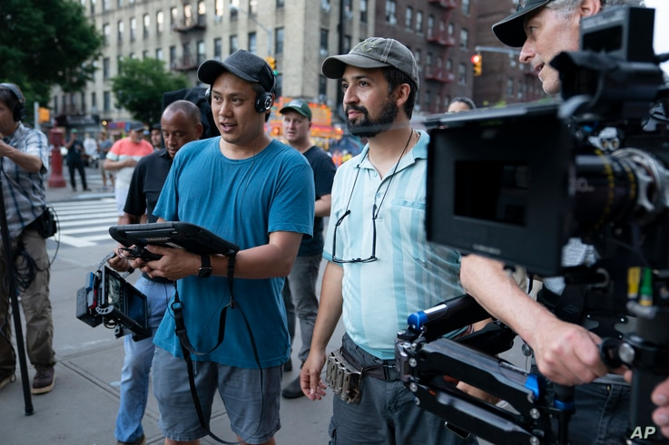 This image released by Warner Bros. Pictures shows director John Chu, left, and Lin-Manuel Miranda on the set of 'In the...