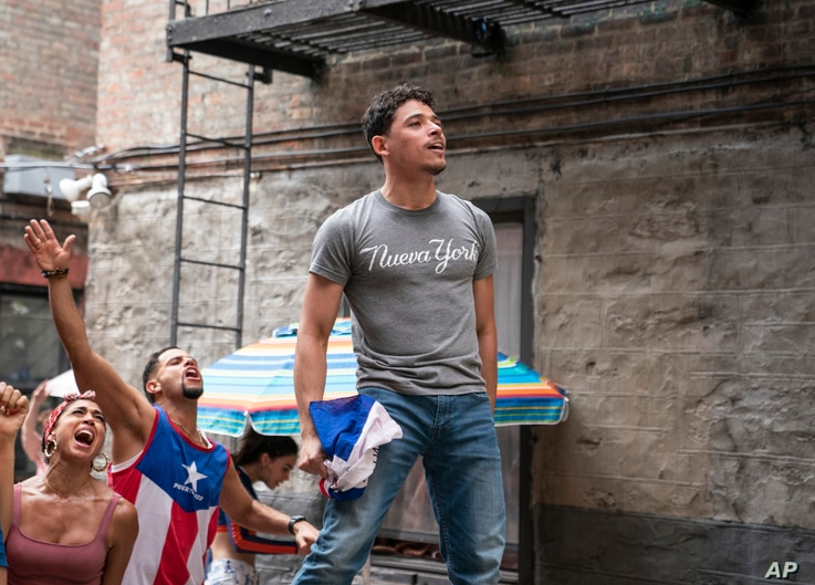 This image released by Warner Bros. Pictures shows Anthony Ramos in a scene from 'In the Heights.'