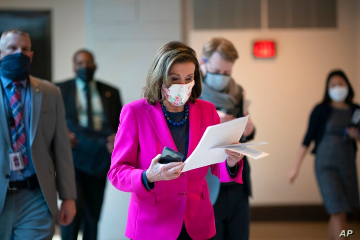 FILE - In this Thursday, Feb. 25, 2021 file photo, Speaker of the House Nancy Pelosi, D-Calif., walks to a news conference as...