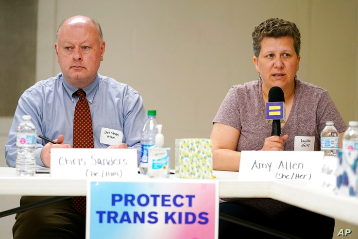 FILE - In this Friday, May 21, 2021 file photo, Amy Allen, the mother of an eighth grade transgender son, speaks at a Human...