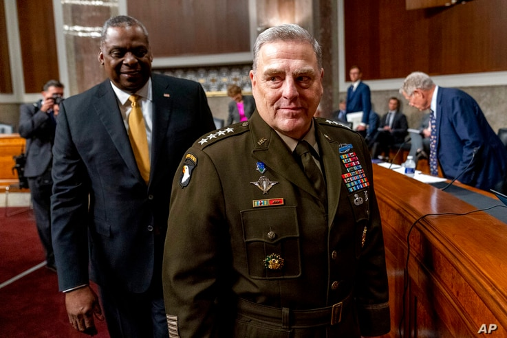 Secretary of Defense Lloyd Austin, left, and Chairman of the Joint Chiefs of Staff Gen. Mark Milley, right, arrive for a Senate…