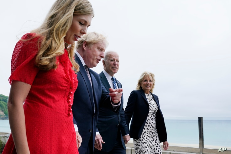 President Joe Biden and first lady Jill Biden are greeted and walk with British Prime Minister Boris Johnson and his wife Carrie Johnson, ahead of the G-7 summit.