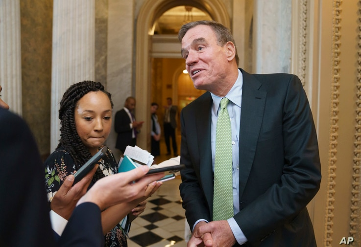 Senator.  Mark Warner, D-Virginia, chair of the Senate Intelligence Committee, pauses in fore of reporters during a vote at the Capitol in...