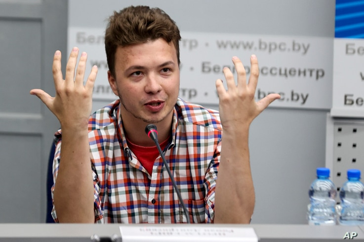 Belarusian dissident journalist Raman Pratasevich gestures while speaking at a news conference at the National Press Center of…