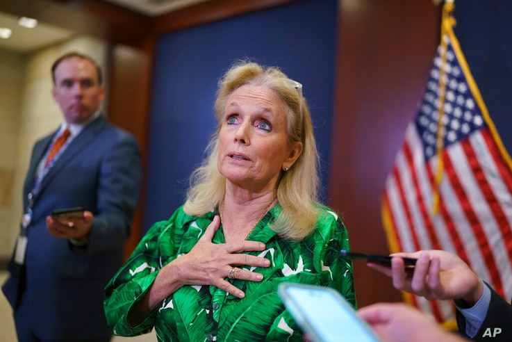 Rep. Debbie Dingell, D-Mich., pauses for reporters after a meeting of the House Democratic Caucus, Tuesday, June 15, 2021, at...