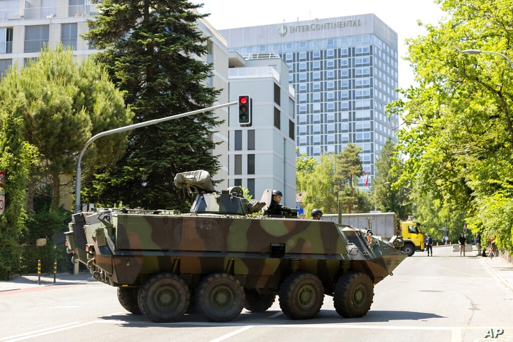 An armored vehicle and a truck block roadway access to the Inter Continental hotel before the arrival of United States...