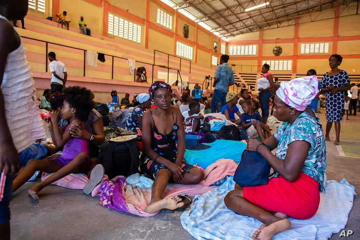 In this handout released Tuesday, June 15, 2021 by UNHaiti, internally displaced people sit inside a shelter at the Center…