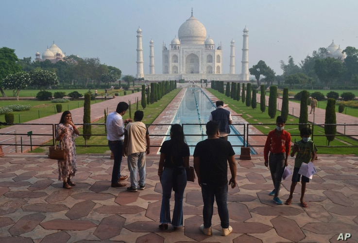 FILE - A small group of tourists visit the Taj Mahal in Agra, India,September 21, 2020.