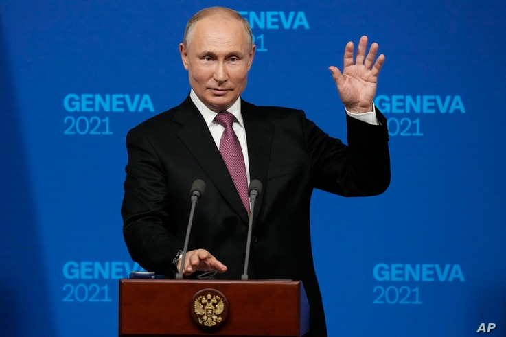 Russian President Vladimir Putin speaks during a news conference after his meeting with U.S President Joe Biden in Geneva.