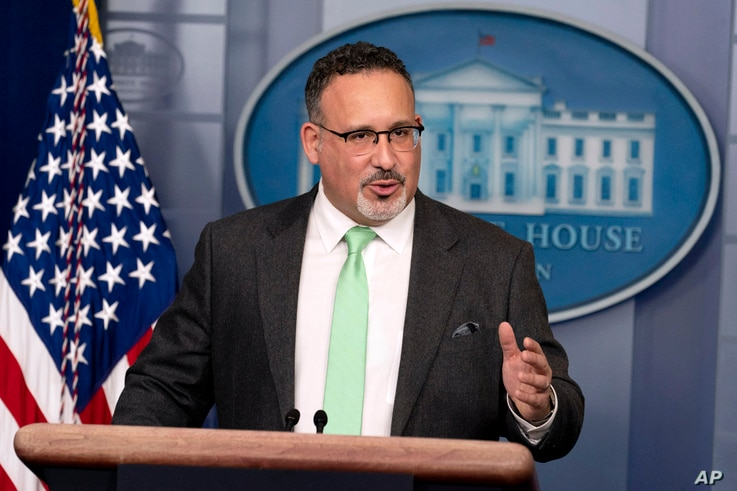 FILE - In this March 17, 2021, file photo, Education Secretary Miguel Cardona speaks during a press briefing at the White House...